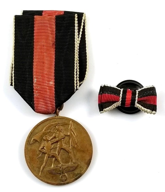 1 October 1938 Commemorative Medal (German: Die Medaille zur Erinnerung an den 1. Oktober 1938), commonly known as the Sudetenland Medal